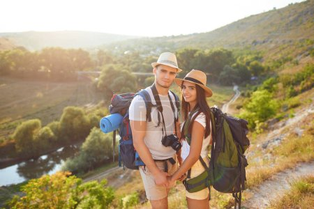 Photo for The guy and the girl with backpacks on hikking the nature. Travel,tourism,people,backpack concept - Royalty Free Image