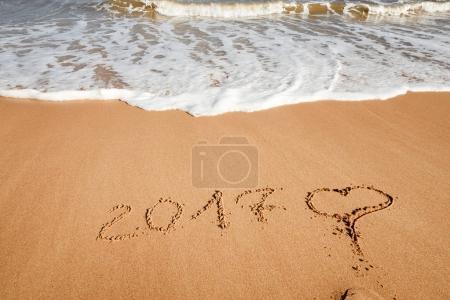2017 lettering on beach sand