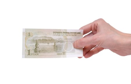 Female hand holding a 1  Chinese Yuan banknote iso...