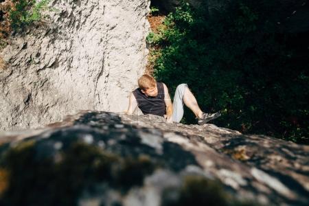 Man climbing up rock