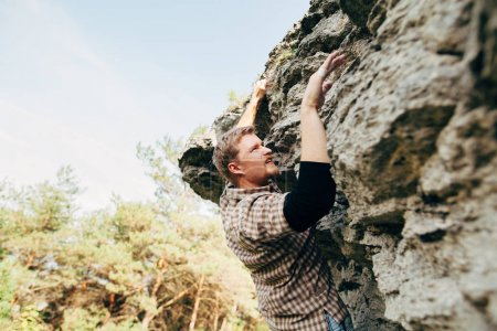Man climbing up rock