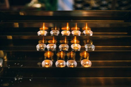 Burning candles on church altar