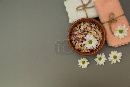 towels and flowers on a gray background
