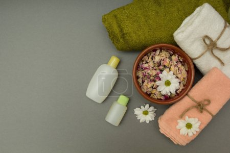 Spa relaxation with towels and flowers