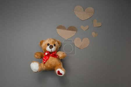 Teddy bear and paper hearts