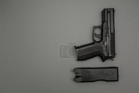 Electric shock machine and gun on grey background...