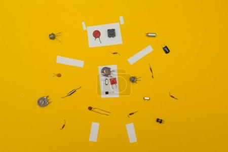 Disassembled robot on a yellow