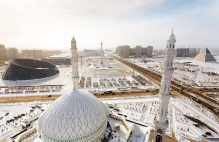 View from the minaret of the Mosque Hazrat Sultan at Independence Square with Palace of Shabyt and Monument in Astana, Kazakhstan.