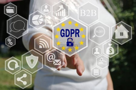 The businesswoman chooses the GDPR on the touch screen .General
