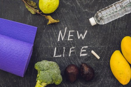 New life is written on chalk board. New life concept