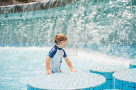 Boy playing in the paddling pool