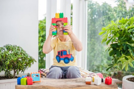 Boy with colorful plastic blocks