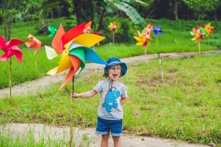 little boy and a pinwheel windmill