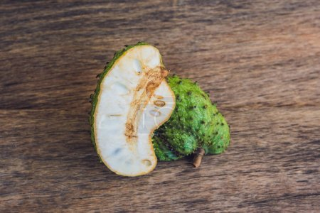 Guanabana on an old wooden background