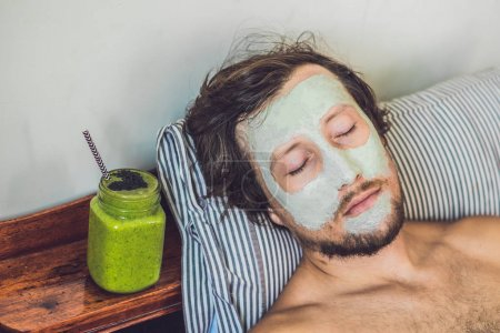 man applying  green clay Mask