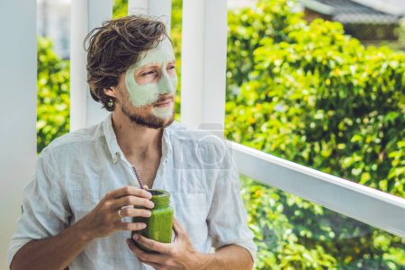man with green clay Mask and  smoothie