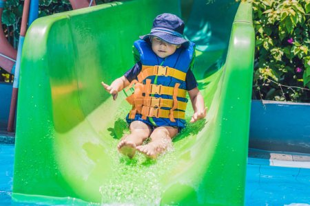 boy  slides down from a slide