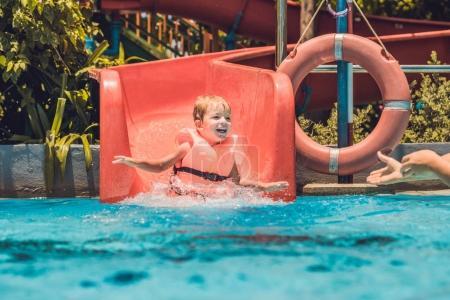 boy  slides down from a slide