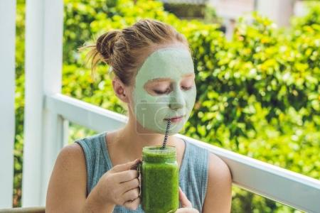 Woman applying Facial green clay Mask