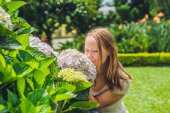 Young woman with  hydrangea