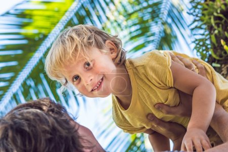 Father and son have fun in the tropics