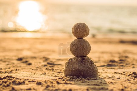 Sandy christmas snowman at sunny beach. Holiday concept for New Years Cards.