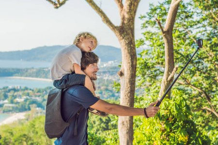 Father and son on Karon View Point in sunny day. Phuket. Traveling with children concept.