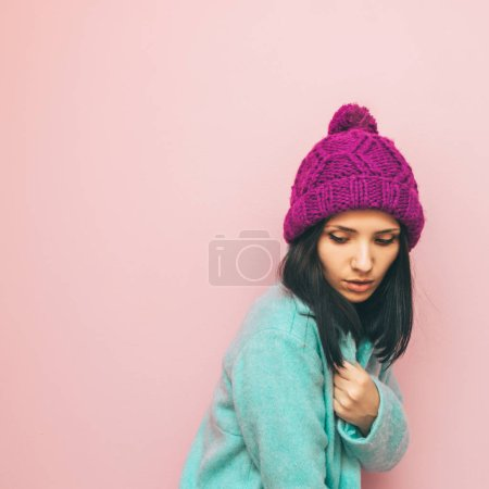 girl in pastel winter clothing