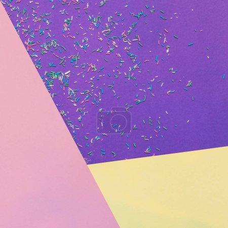 Foto de Paper texture background of fashion ultra violet and yellow colors with confetti. Minimal concept. Flat lay, Top view. - Imagen libre de derechos