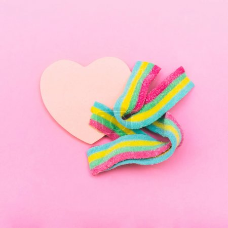 rainbow bubble gum with heart on pink background