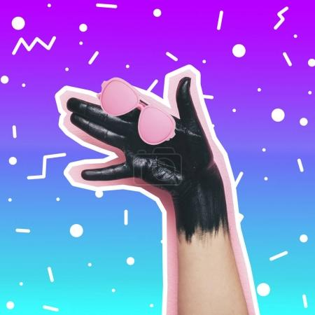 hand makes the gesture of a dog with glasses on gradient background. crazy art collage