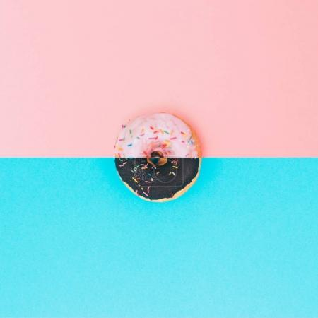 Photo for Art collage of chocolate and pink donuts with topping. Minimalism and surrealism - Royalty Free Image