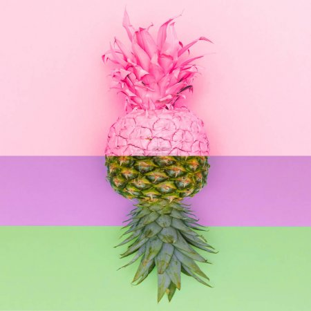 Mirror reflection of colored pineapple with half raw part. Contemporary art collage. Minimal design fashion concept