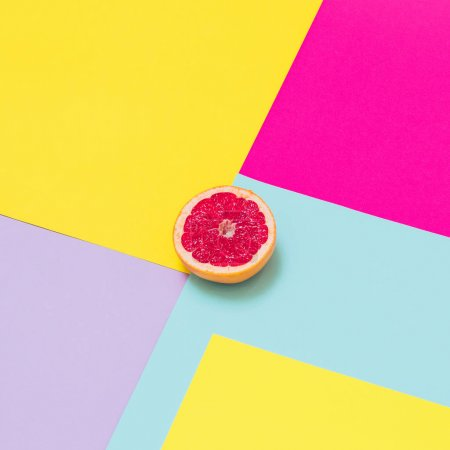 Photo for Juicy half of grapefruit on geometric background. - Royalty Free Image