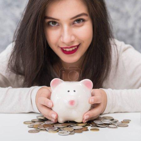 Photo for Beautiful young girl saving money for holiday season, saving money concept - Royalty Free Image