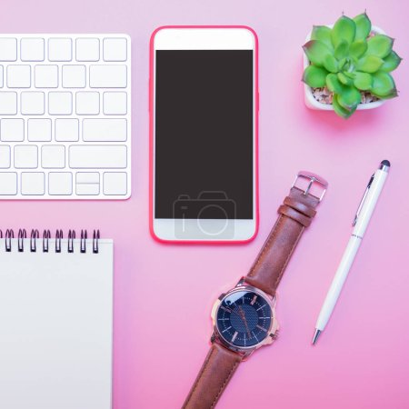 Photo pour Creative flat lay of workspace desk, office stationery and lifestyle objects on pink background with copy space - image libre de droit