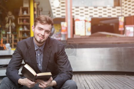 Photo for Closeup on a man reading a bible at shopping mall, believe concept - Royalty Free Image