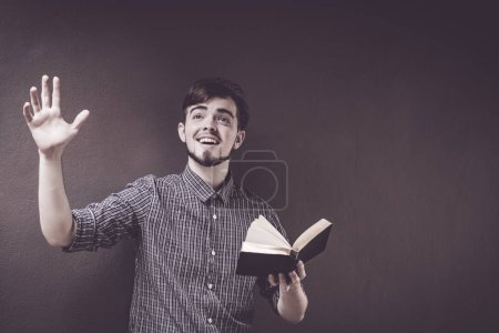 Photo for Closeup on a man holding a bible and pray, believe concept - Royalty Free Image