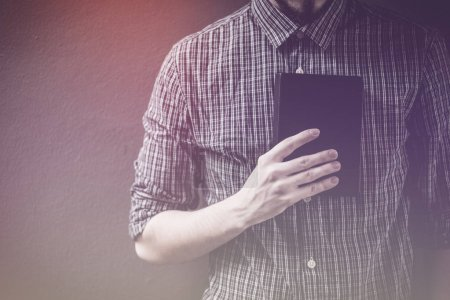 Photo for Closeup on a man holding a bible at shopping mall, believe concept - Royalty Free Image