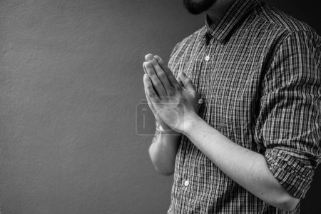 Photo for Closeup on a young man pray, believe concept - Royalty Free Image