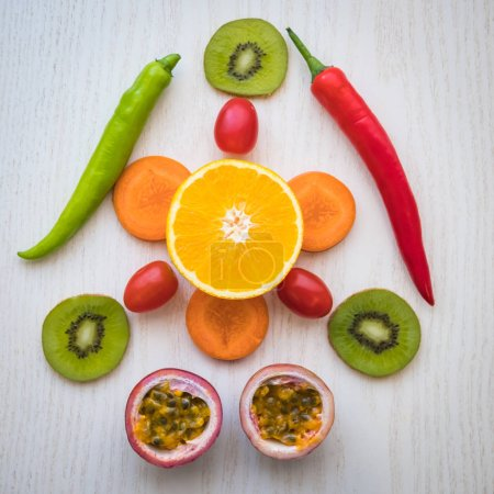 Photo for A selection of fresh vegetables and fruits for a heart healthy diet as recommended by doctors and medical professionals - Royalty Free Image