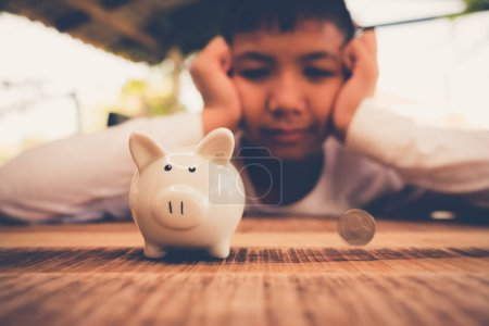 Photo for Young asian boy Saving money for the future - Royalty Free Image