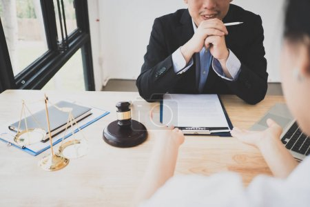 Photo for Client and lawyer have a sit down face to face meeting to discuss the legal options available - Royalty Free Image