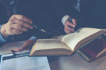 Photo for Client and lawyer discuss the legal options available - Royalty Free Image