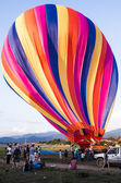 Colorful balloons flying over the mountain and travel concept in Laos