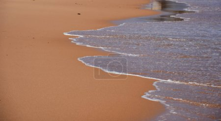 Wave and sand beach for background