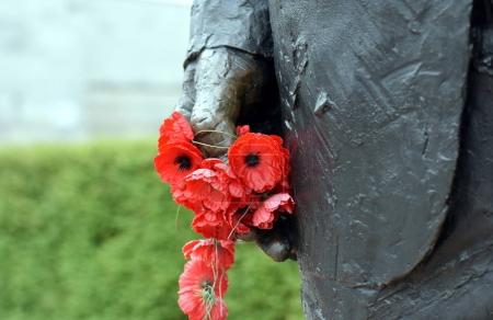 Poppies in a statue hand