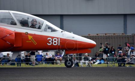 Pilot waving after landing from his Marchetti S211