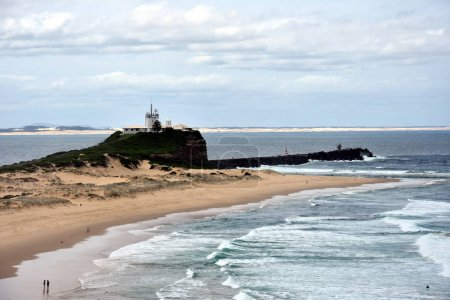 Beach at Newcastle with Nobbley's Lighthouse in the background