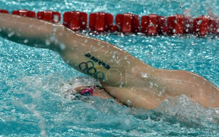 """""""Never give up"""" and olympic rings on the arm of Peter BERNEK"""